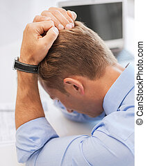 stressed businessman at work - business, office and health...