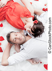 red white - dreaming valentine couple on floor