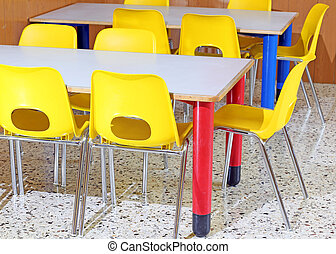 Classroom with chairs and tables in the kindergarten -...