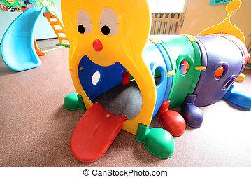 huge game in plastic in the hall of kindergarten - big game...