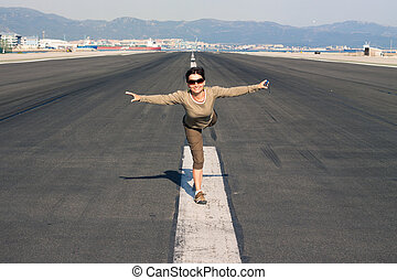 Happy woman imitating airplane - Happy woman tourist...