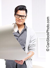 Architect in the studio - Handsome man while working on a...