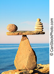 Steadiness - Well-balanced of pebbles on the top of stone