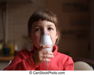 inhaler - child breathes into the inhaler
