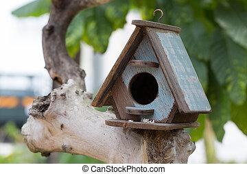 Bird house on the tree.