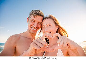 sweetheart - happy traveling couple summertime beach