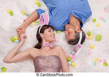 easter - happy easter couple lying smiling