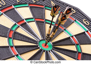 darts in dartboard on white background