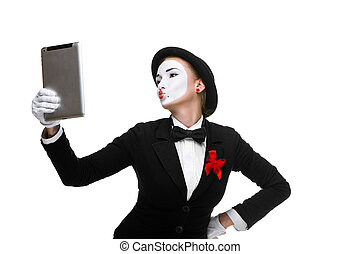 business woman in the image mime holding tablet PC and...