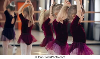 Cuteness Overload - Little girls in ballet classroom moving...