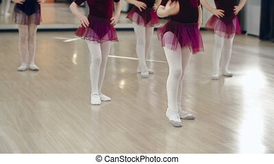 Gymnastic Training - Low section of five little ballerinas...
