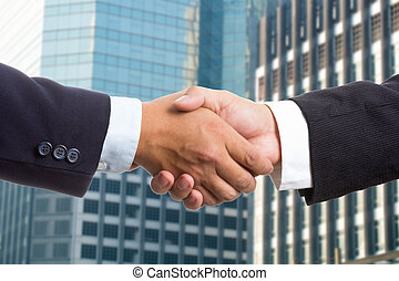 Businessman shake hands for deal thier business.