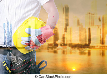 Labor Day - Worker holding tool with Twilight time on Labour...