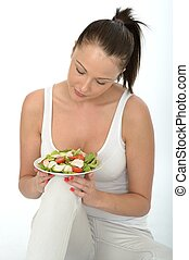 Healthy Young Woman Holding a Plate of Chicken Salad