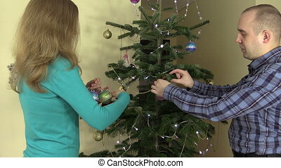 couple fir tree christmas - Married couple man and woman...