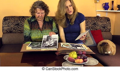woman with grandma photos - Happy granddaughter woman with...