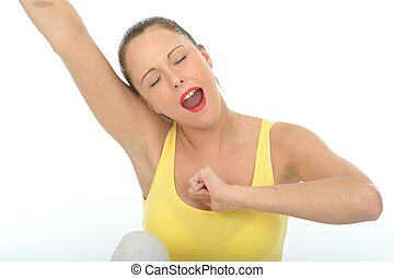 Attractive Young Woman Stretching and Yawning Wearing a...