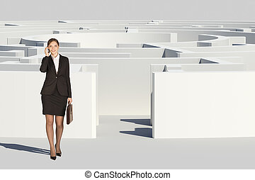 Businesswoman with suitcase going out labyrinth -...