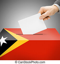 Ballot box painted into national flag - East Timor - Ballot...