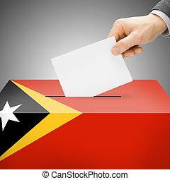 Ballot box painted into national flag - East Timor - Ballot...