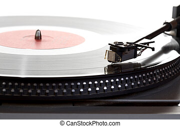 Old player and vinyl phonograph record on a white background...