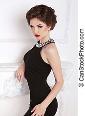 Fashion beautiful brunette girl model in black dress posing...