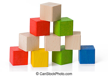 Wooden toy blocks on white background