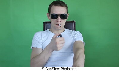 young man smoking green screen
