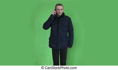 young man talking at phone