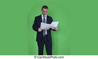 business man watching documents green screen