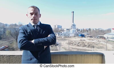 Pensively business man industrial zone
