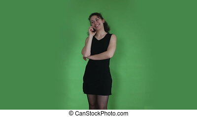 young girl talking at phone green screen