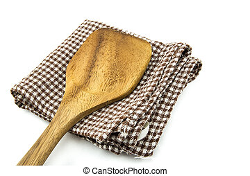 wooden spade of frying pan and napery isolated on white...