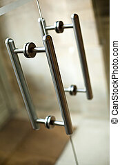 Handles - Stylish aluminum handles of a glass door
