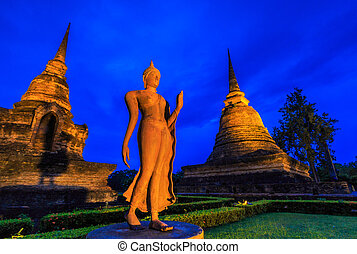 Buddha Twilight Sukhothai historical park, the old town of...