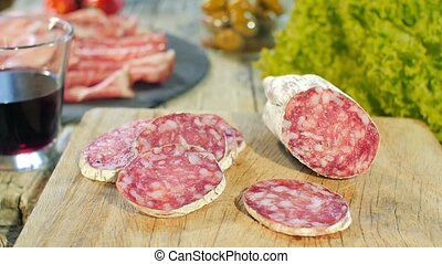 salami on wooden cutting Board - salami is a traditional...