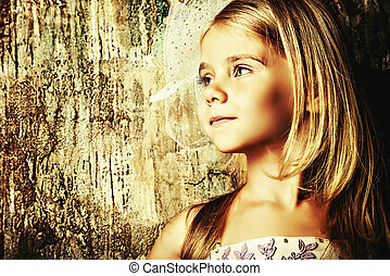 headdress - Art portrait of a pretty little girl wearing...