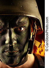 infantry - Close-up portrait of a brave soldier in war paint...