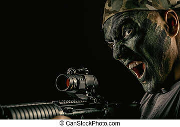 mad fighter - A soldier in war paint looks through the scope...