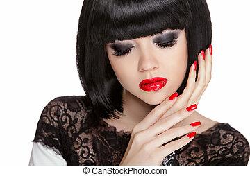 Makeup. Manicured nails. Black bob short hair styling. Brunette