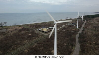 An aerial view of a wind farm by the sea
