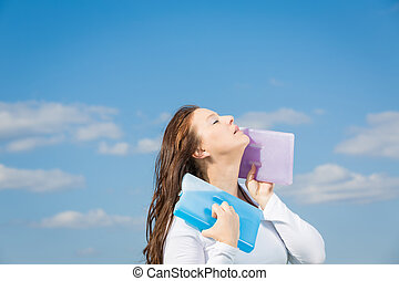 cool in the summer heat - woman holing a cold pack at his...