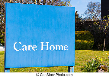 Weathered Sign for elderly people 'Care Home' at the entrance of