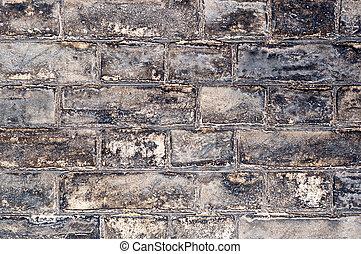 Weathered yellow brick wall landscape view