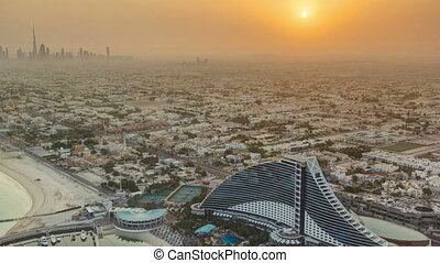 Sunrise. Aerial View of Jumeirah Beach from Burj Al Arab,...