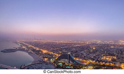 Skyline view of Dubai from night to day transition, UAE...