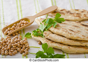 Lebanese bread, pita bread, nice and fresh chickpeas in...