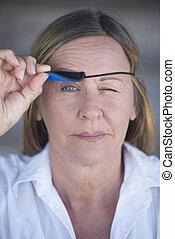 Confident woman lifting eye patch portrait - Portrait...