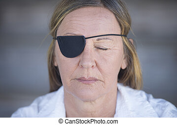 Mature woman with eye patch portrait - Portrait attractive...