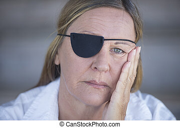 Tired woman with eye patch portrait - Portrait depressed...